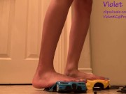 Toy cars crushed under teen heels download
