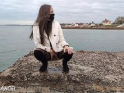 PUBLIC POWERFUL PISS ON THE SEA FROM A HOT BRUNETTE IN STOCKINGS AND A SKIRT video